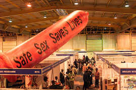 A giant condom inflates over the exhibition stands at Nasrec Exhibition Center, Johannesburg, South Africa, August 2002. (AP Photo/Obed Zilwa)