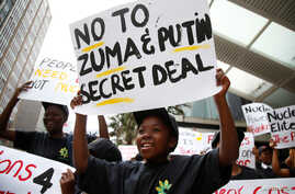 FILE - Environmental activists protest against the use of nuclear power in Durban, South Africa, Dec. 14, 2016.