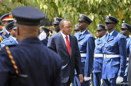 Kenyan President Uhuru Kenyatta inspects a guard of honour as he arrives at the Parliament Building to deliver his state of the nation address in Nairobi, March 27, 2014.