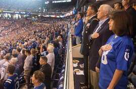 Vice President Mike Pence, second lady Karen Pence, and Major General Courtney P. Carr stand for the singing of the national anthem at Lucas Oil Stadium before the start of the Indianapolis Colts game against the Francisco 49ers, prior to leaving the