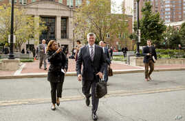 Members of the defense team for Paul Manafort, Kevin Downing, center, and Thomas Zehnle, center right, depart the federal court following a hearing in the criminal case against former Trump campaign chairman Paul Manafort in Alexandria, Va., Friday,