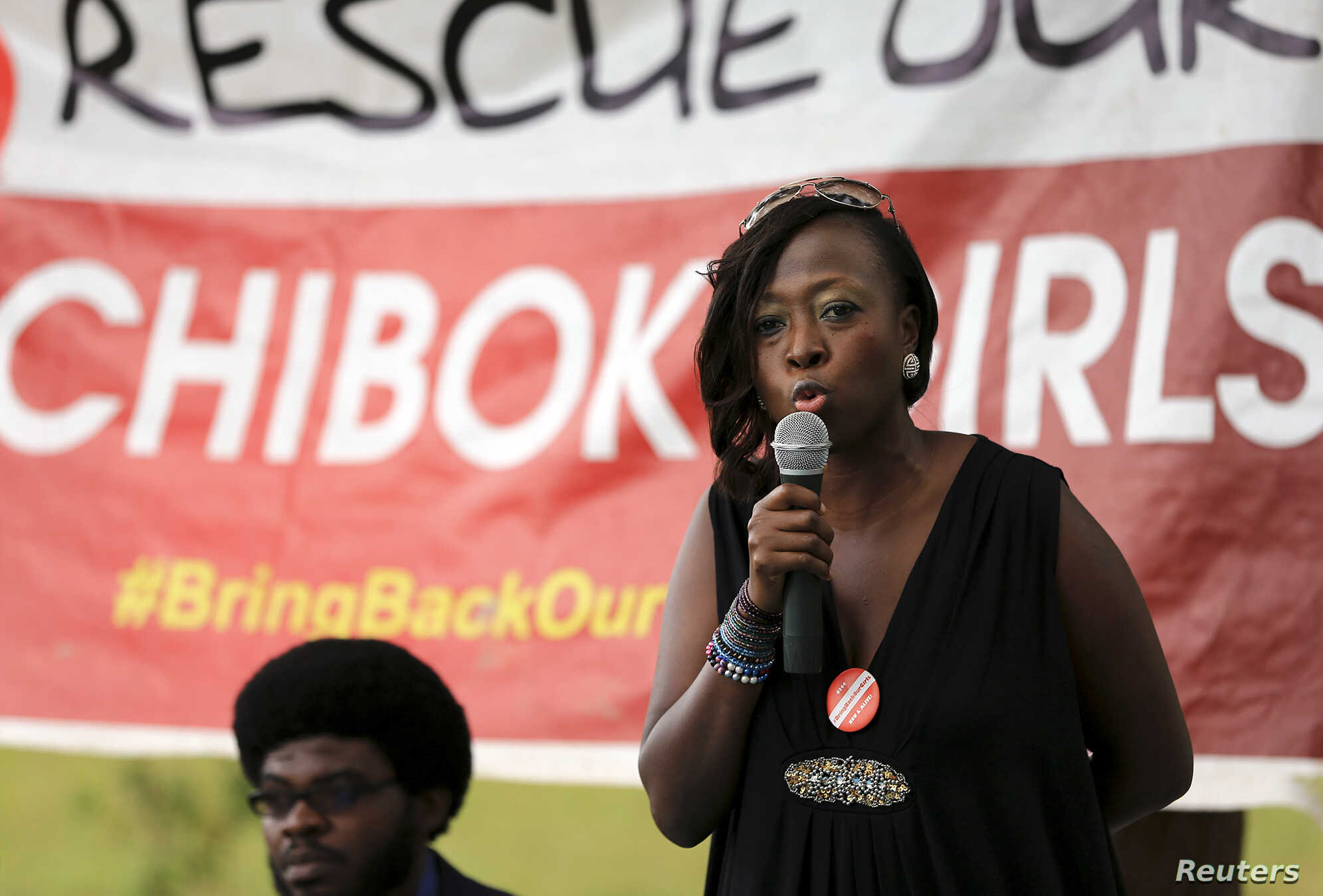 "Maureen B. Kabrik, a ""#Bring Back Our Girls"" campaigner, speaks during a sit-out meeting in support of the release of more than 200 Nigerian schoolgirls, who were abducted by the Boko Haram in Borno State on April 14, at the Unity fountain in Abuja A"