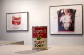 """Andy Warhol's """"Campbell's Chicken with Rice Soup,"""" tin soup can filled with concrete, has a pre-auction estimate of $50,000-70,000, on display at Christie's, New York City, Feb. 22, 2013."""