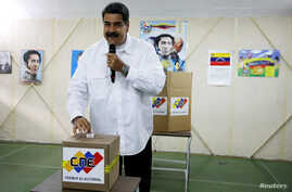 Venezuela's President Nicolas Maduro takes part in a voting drill, ahead of May 20 presidential election, in Caracas, Venezuela, May 6, 2018.