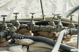 Fuel valves of only two remaining fuel pools stand during work to shrink Bagram Air Field in the Parwan province of Afghanistan, Jan. 2, 2015.