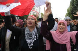 Tunisian women during a gathering at Habib Bourguiba avenue in Tunis to celebrate the one year anniversary of the revolution, January 14, 2012.