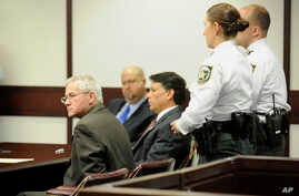 Oscar Ray Bolin Jr., far left, sits with handcuffs on after being found guilty in the killing of Natalie Blanche Holley, April 19, 2012.