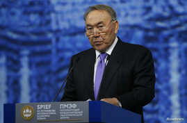 FILE - Kazakh President Nursultan Nazarbayev delivers a speech during a session of the St. Petersburg International Economic Forum 2016 in St. Petersburg, Russia, June 17, 2016.