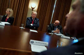 U.S. President Donald Trump meets with members of Congress and U.S. law enforcement, discussing crime and immigration issues, specifically the MS-13 gang, at the White House in Washington, Feb. 6, 2018.