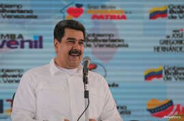Venezuela's President Nicolas Maduro attends an event with supporters in Caracas, Venezuela, Nov. 13, 2018.