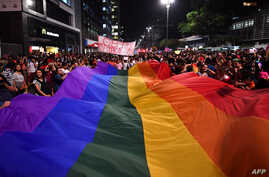 People protest against the decision of a Brazilian judge who approved gay conversion therapy in Sao Paulo, Brazil on Sept. 22, 2017.