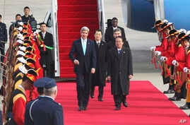 U.S. Secretary of State John Kerry, center left, inspects a guard of honor with South Korean Deputy Foreign Minister Lee Kyung-soo, center right, upon his arrival at Seoul military airport in Seongnam, South Korea, Thursday, Feb. 13, 2014.