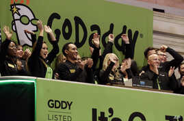 GoDaddy CEO Blake Irving joins the celebration during New York Stock Exchange opening bell ceremonies for his company's IPO, April 1, 2015. GoDaddy is one of two internet companies to begin to police hate speech on the internet.