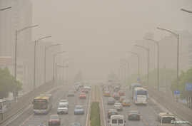 Vehicles are seen on roads during a dust storm in Beijing, China, May 4, 2017.