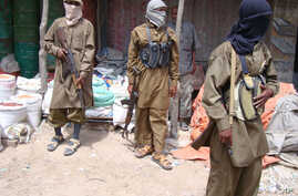 FILE - Armed Al-Shabab fighters patrol in Mogadishu, Somalia, June 29, 2009. Somalia's al-Shabab militants announced Dec. 21, 2018, a military offensive aimed at getting rid of Islamic State-related militants in the country.