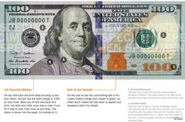 FILE - New U.S. $100 bill to be released Oct. 8, 2013.
