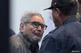 Shining Path founder Abimael Guzman attends a trial during sentence of a 1992 Shining Path car bomb case in Miraflores, at a high security naval prison in Callao, Peru, Sept. 11, 2018.