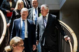 Secretary of State Rex Tillerson, right, and Defense Secretary Jim Mattis arrive on Capitol Hill in Washington, Aug. 2, 2017, to brief the Senate Foreign Relations Committee behind closed doors regarding the administration's perspective on the author