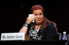 Heather Gooze, a Las Vegas shooting witness, cries as she testifies during a Senate Judiciary Committee hearing on gun legislation Capitol Hill in Washington, Dec. 6, 2017.