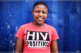 Nandi Makhele, 25, poses for a portrait while wearing a T-shirt indicating that she is HIV-positive, in Cape Town's Khayelitsha township February 15, 2010. Some 5.6 million people live with HIV/AIDS in South Africa - more than in any other country.