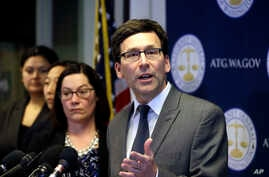 Washington State Attorney General Bob Ferguson speaks at a news conference about the state's response to President Trump's revised travel ban in Seattle, March 9, 2017.