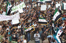 Syrian Forces Strike Homs for Second Day, Dozens Reported Dead