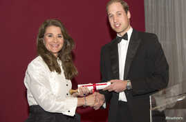 Britain's Prince William, right, presents philanthropist Melinda Gates with the Chatham House Prize at the Banqueting House in London, Nov. 21, 2014.