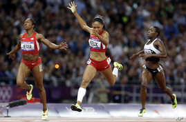 United States'  Allyson Felix crosses the finish line to win the women's 200-meters final ahead of compatriot Carmelita Jeter, left, and Ivory Coast's Murielle Ahoure during the athletics in the Olympic Stadium at the 2012 Summer Olympics, London, We