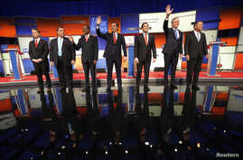 Republican presidential candidates Sen. Rand Paul, Gov. Chris Christie, Dr. Ben Carson, Sen. Ted Cruz, Sen. Marco Rubio, former Gov. Jeb Bush and Gov. John Kasich stand onstage at the start of the Republican presidential debate in Des Moines, Iowa Ja
