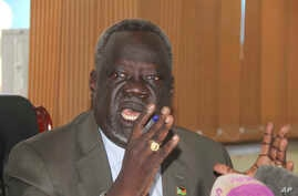 South Sudan Minister of Health Dr. Riek Gai Kok speaks  during a press conference in Juba, South Sudan, June 2, 2017. South Sudan's government says 15 young children have died in a botched measles vaccination campaign that saw people as young as 12 y