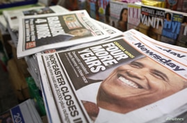 A view shows newspapers with Barack Obama winning the U.S. presidential election on their frontpages, at a news stand in Times Square, New York, November 7, 2012.
