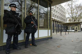Police officers patrol outside the U.S. embassy in London December 9, 2014. The Senate Intelligence Committee prepared to release a report on the CIA's anti-terrorism tactics on Tuesday and U.S. officials moved to shore up security at American facili
