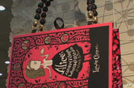 A copy of the book, 'Alice in Wonderland,' becomes a purse.