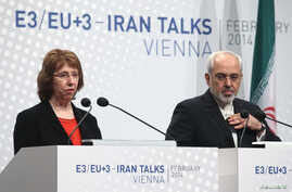 European Union foreign policy chief Catherine Ashton (L) and Iranian Foreign Minister Mohammad Javad Zarif deliver a statement after a conference in Vienna, Feb. 20, 2014.