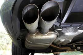 FILE - The exhaust system of a Volkswagen Passat TDI diesel car is seen in Esquibien, France, Sept. 23, 2015.