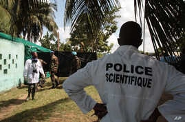 Forensic scientists and doctors prepare for the exhumation of a mass grave site on the grounds of a mosque, in the Yopougon district of Abidjan, Ivory Coast, April 4, 2013.