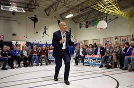 United States Sen. Cory Booker, D-N.J., center, addresses an audience during a 2020 presidential campaign stop in the gymnasium of a school, Sunday, April 7, 2019, in Londonderry, N.H.