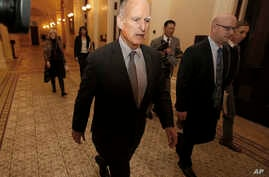 FILE - California Gov. Jerry Brown returns to his office after a meeting in Sacramento, California, April 6, 2017. Brown and the California Legislature are among this year's winners of the Jefferson Muzzles, satiric awards bestowed by a free speech g