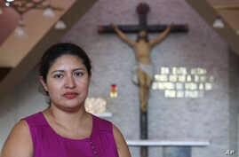 Cecilia Flores poses for a portrait inside the chapel where Archbishop Oscar Arnulfo Romero was assassinated in 1980, in San Salvador, El Salvador, Oct. 5, 2018. Flores underwent an emergency cesarean section and was diagnosed with an infection that