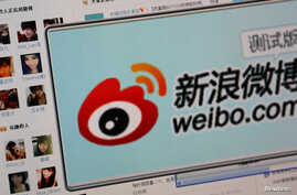 "FILE - The logo of Sina Corp's Chinese microblog website ""Weibo"" is seen on a screen in this photo illustration taken in Beijing."