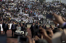 Pope Francis arrives for Mass in a golf cart at Venustiano Carranza stadium in Morelia, Mexico, Tuesday, Feb. 16, 2016.