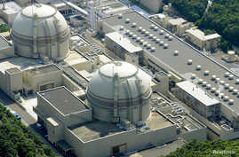 FILE - An aerial view shows Kansai Electric Power Co's Ohi nuclear power plant's No. 4 reactor (front) in Ohi, Fukui prefecture.