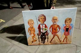 Artist Kaya Mar's painting marks the start of the British election campaign race in central London, April 26, 2017. Pictured are (from left) Liberal Democrats party leader Tim Farron, British Prime Minister and Conservative party leader Theresa May,