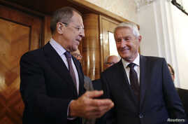 Russia's Foreign Minister Sergei Lavrov (L) welcomes Secretary-General of the Council of Europe Thorbjorn Jagland before their meeting in Moscow, September 4, 2014.