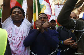Ethiopian migrants, all members of the Oromo community of Ethiopia living in Malta, protest in Valletta against the Ethiopian regime's plan to evict Oromo farmers to expand Ethiopia's capital, Addis Ababa, Dec. 21, 2015.
