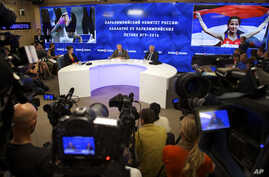 FILE - A Monday, Aug. 8, 2016 photo from files showing the President of the Russian Paralympic Committee Vladimir Lukin, background centre right, during a news conference in Moscow.