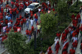 Members of the Economic Freedom Fighters party holds placards during their march for economic transformation outside the Johannesburg Stock Exchange in Johannesburg, Oct. 27, 2015.