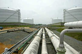 FILE - Pipelines running from the offshore docking station to four liquefied natural gas (LNG) tanks at the Dominion Resources Inc. Liquefied Natural Gas facility in Cove Point, Maryland, are seen in a June 13, 2003, photo.
