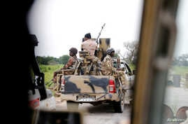 FILE - A Nigerian army convoy vehicle drives ahead with an anti-aircraft gun on its way to Bama, Borno State, Nigeria, Aug. 31, 2016.