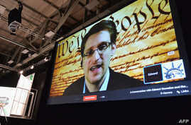 """NSA whistleblower Edward Snowden speaks via videoconference at the """"Virtual Conversation With Edward Snowden"""" during the 2014 SXSW Music, Film + Interactive Festival at the Austin Convention Center, March 10, 2014."""